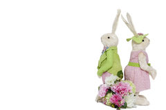 Rabbit couple standing back to back with flower bouquet over white background Stock Photography