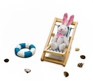 Rabbit in deck chair Stock Photos
