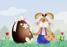 Rabbit decorates Easter egg Stock Image