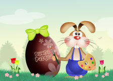 Rabbit decorates Easter egg Stock Images