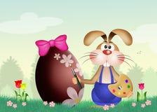 Rabbit decorates Easter egg Stock Photos