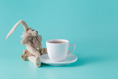 Rabbit doll with cup of coffee Stock Photos