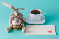 Rabbit doll with cupcake Stock Photography