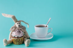Rabbit doll with cupcake Stock Images