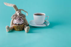 Rabbit doll with cupcake Stock Image