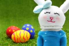 Rabbit doll and easter egg Stock Images