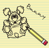 Rabbit drawn in pencil in notebook sheet Stock Images