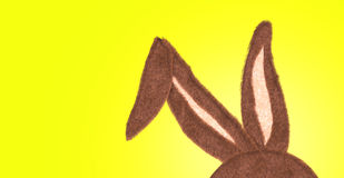 Rabbit Ear with the idea of Happy Easter on yellow Stock Photo