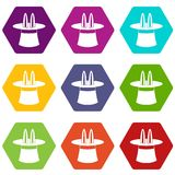 Rabbit ears appearing from a top magic hat icon set color hexahedron. Rabbit ears appearing from a top magic hat icon set many color hexahedron isolated on white Stock Image