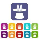 Rabbit ears appearing from a top magic hat icons. Set vector illustration in flat style in colors red, blue, green, and other Stock Image