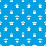 Rabbit ears appearing from a top magic hat pattern seamless blue. Rabbit ears appearing from a top magic hat pattern repeat seamless in blue color for any design Royalty Free Stock Images