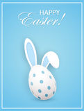 Rabbit ears and Easter egg on blue background Stock Photo