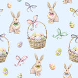 Rabbit with Easter basket on a blue background. Color Easter eggs. Watercolor drawing. Handwork. Seamless pattern.  stock illustration