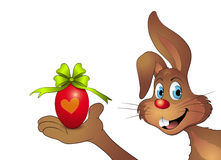 Rabbit with Easter egg in Hand. Clip-Art Stock Photos