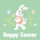 Rabbit and Easter egg. The white rabbit holds a big Easter egg Royalty Free Stock Photos