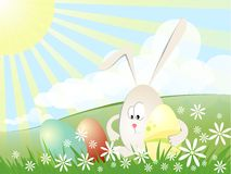 Rabbit with easter eggs. In sunny Easter day Stock Photography
