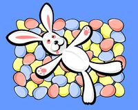 Rabbit and easter eggs. The rabbit laying on multi-colored easter eggs Stock Images