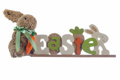 Rabbit and Easter sign against white. Rabbit and Easter sign. Wooden sign that says Easter with a rabbit Royalty Free Stock Image