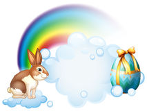 A rabbit and an egg near the rainbow Stock Photography