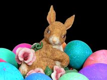 Rabbit and Eggs. Rabitt figure and colored eggs macro Stock Image