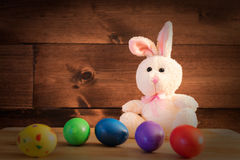 The Rabbit and the Eggs. An Ester Rabbit and five colored eggs Stock Photos