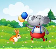 A rabbit and an elephant with balloons Stock Image