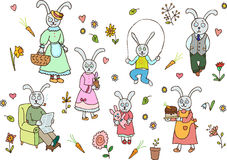 Rabbit family. Mother, father, grandfather, grandmother, two daughters and son Royalty Free Stock Photography