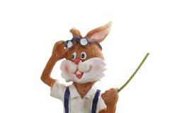 Rabbit figurine holding stick Stock Photos