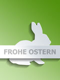 Rabbit with Frohe Ostern over green background Stock Photo