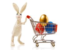Rabbit with a gift. Easter rabbit carries the cart with multi-coloured eggs Stock Image