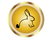Rabbit in gold icon Stock Photos