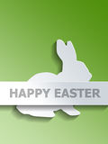 Rabbit with Happy Easter label over green Stock Image