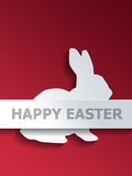 Rabbit with Happy Easter label over red Stock Photography