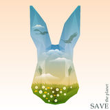 Rabbit head with green meadows and silhouettes of swans flying in the blue sky with clouds. Stock Images