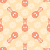 Rabbit head in the shape of an egg and cartoon flowers. Easter seamless pattern. Royalty Free Stock Image