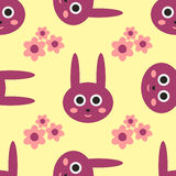 Rabbit head with a smiling face. Abstract flowers. Cartoon seamless pattern. Vector illustration. Colorful children`s print. Pink, purple, yellow Royalty Free Stock Images