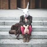 Rabbit head woman Stock Photography