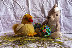 Easter. Rabbit, hen quilling easter egg and whip the hay Stock Photos