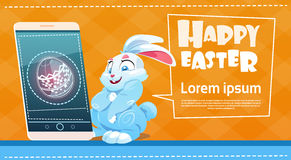 Rabbit Hold Cell Smart Phone Decorated Colorful Eggs Easter Holiday Symbols Greeting Card Royalty Free Stock Image