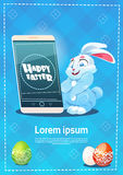 Rabbit Hold Cell Smart Phone Decorated Colorful Eggs Easter Holiday Symbols Greeting Card Royalty Free Stock Photography