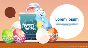 Rabbit Hold Cell Smart Phone Decorated Colorful Eggs Easter Holiday Symbols Greeting Card Royalty Free Stock Photo