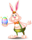 A rabbit holding an easter egg Royalty Free Stock Photography