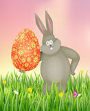 Rabbit holding Easter egg. Vector illustration Stock Images