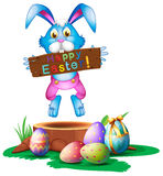 A rabbit holding an easter greeting Royalty Free Stock Image