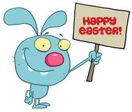Rabbit holding up a happy easter greeting sign Royalty Free Stock Photography