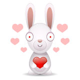 Rabbit holds big heart Stock Image