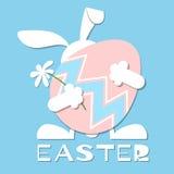 Rabbit holds Easter egg Stock Photos