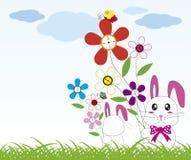 Rabbit holds flowers Stock Photo