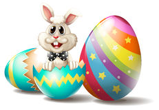 A rabbit inside a cracked easter egg Stock Images