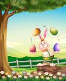 A rabbit juggling the Easter eggs. Illustration of a rabbit juggling the Easter eggs royalty free illustration